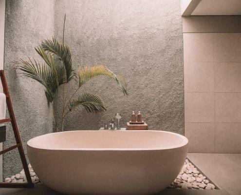 stone and ceramic bathroom in a custom home in dallas